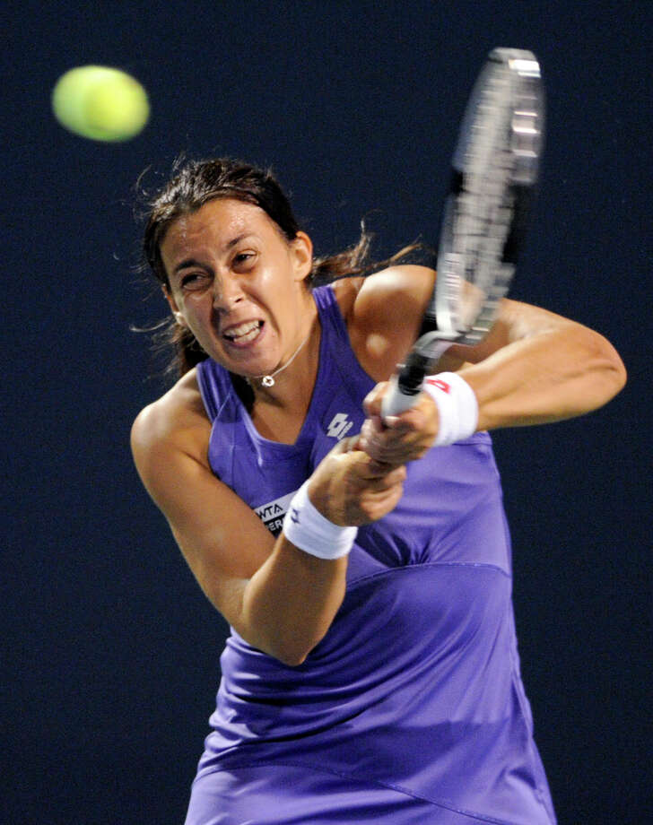 Marion Bartoli, of France, hits a backhand during her 6-4, 6-3 loss to Sara Errani, of Italy in their quarterfinal match at the New Haven Open tennis tournament in New Haven, Conn., on Thursday, Aug. 23, 2012. (AP Photo/Fred Beckham) Photo: Fred Beckham, Associated Press / FR153656 AP