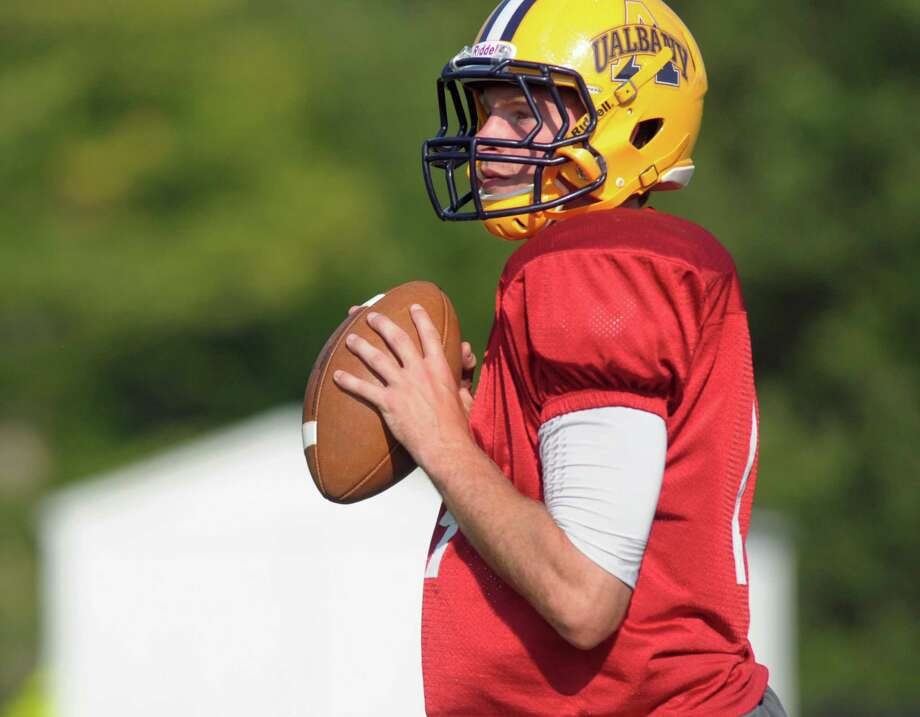 Will Fiacchi, the first-year starting quarter back for the UAlbany football team, runs through drills on Thursday, Aug. 23, 2012 in Albany, NY.   (Paul Buckowski / Times Union) Photo: Paul Buckowski