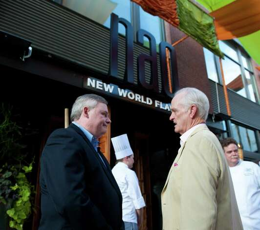 Tim Ryan (left), president of the Culinary Institute of America, and Pearl Brewery founder Kit Goldsbury chat during the grand opening for the Culinary Institute of America's Nao restaurant in the Pearl Brewery on Aug. 23, 2012. Photo: Robin Jerstad, For The Express-News