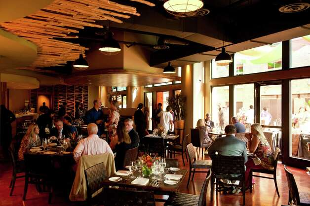 Diners gather inside the Culinary Institute of Americ's Nao restaurant during the grand opening  in the Pearl Brewery on Aug. 23, 2012. Photo: Robin Jerstad, For The Express-News