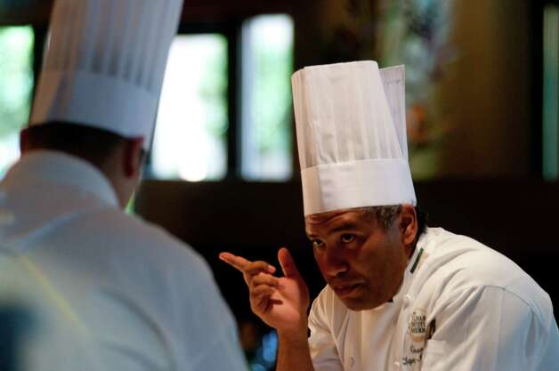 Culinary Institute of America Executive Chef Geronimo Lopez speaks with a student prior to the grand opening for the CIA's Nao restaurant in the Pearl Brewery on Aug. 23, 2012. Photo: Robin Jerstad, For The Express-News