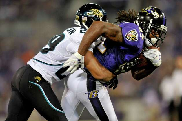 Baltimore Ravens wide receiver Torrey Smith, right, fights through a tackle by Jacksonville Jaguars defensive back William Middleton in the first half of an NFL preseason football game in Baltimore, Thursday, Aug. 23, 2012. (AP Photo/Gail Burton) Photo: Gail Burton