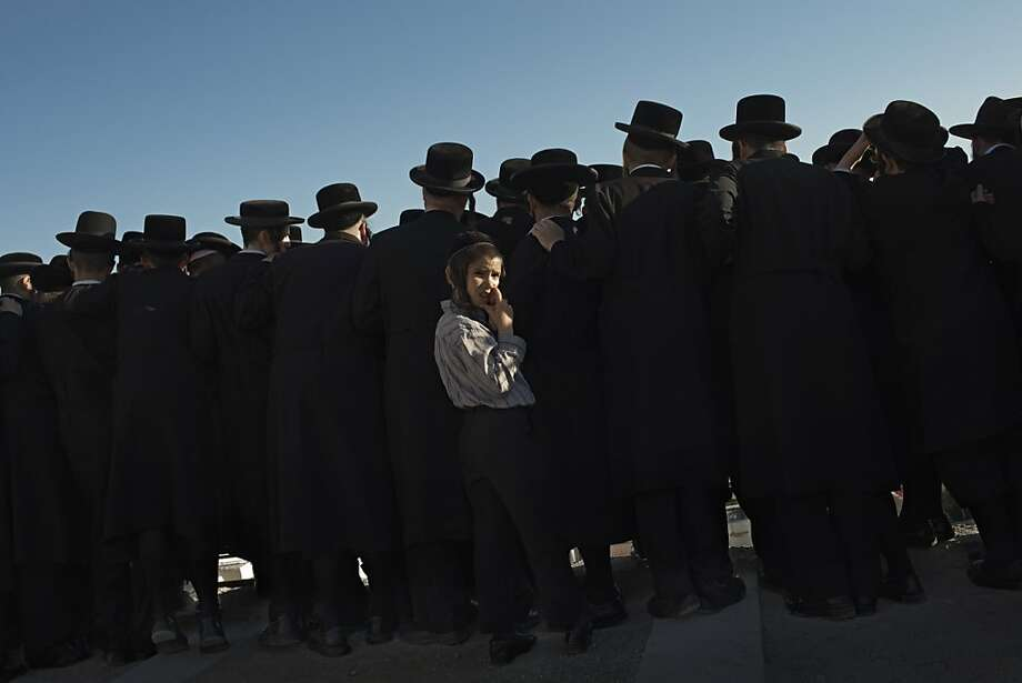 Ultra-Orthodox Jewish men attend the funeral of Rabbi Abraham Chaim Roth on the Mount of Olives in Jerusalem, Thursday, Aug. 23, 2012. Photo: Bernat Armangue, Associated Press