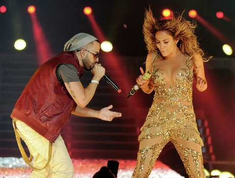 LOS ANGELES, CA - AUGUST 16:  Singers Jennifer Lopez (R) and Yandel (L) of Wisen y Yandel perform at The Staples Center on August 16, 2012 in Los Angeles, California. Photo: Kevin Winter, Getty Images / 2012 Getty Images