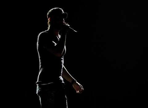 LOS ANGELES, CA - AUGUST 16:  Singer Enrique Iglesias performs at The Staples Center on August 16, 2012 in Los Angeles, California. Photo: Kevin Winter, Getty Images / 2012 Getty Images