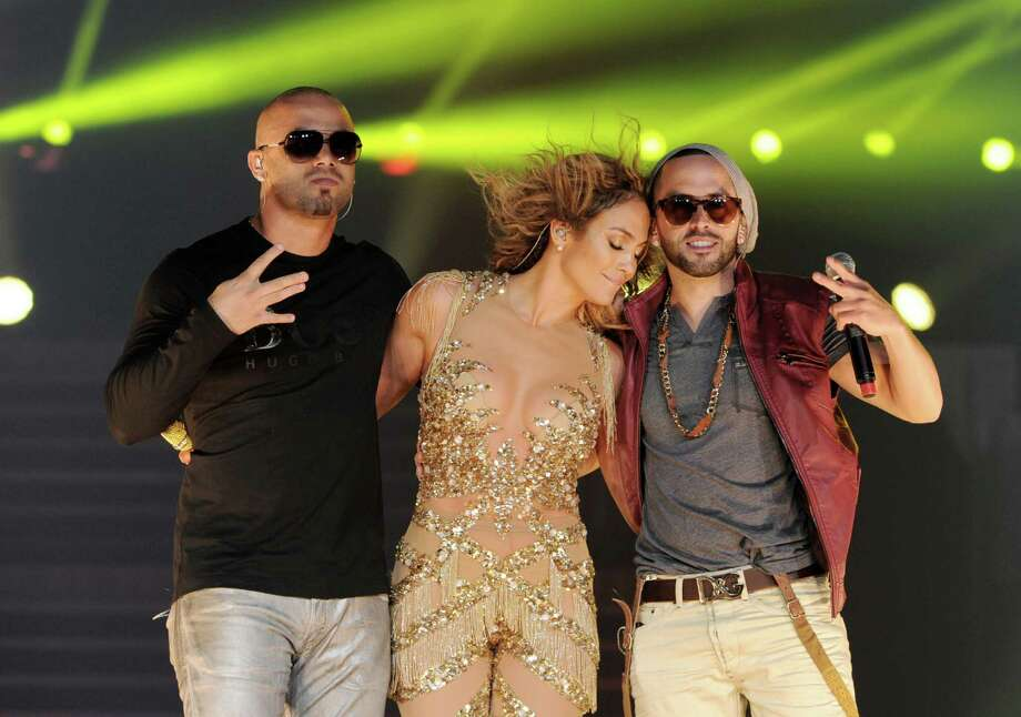 LOS ANGELES, CA - AUGUST 16:  Singers Jennifer Lopez (C) and Wisin (L) and Yandel of Wisin y Yandel perform at The Staples Center on August 16, 2012 in Los Angeles, California. Photo: Kevin Winter, Getty Images / 2012 Getty Images