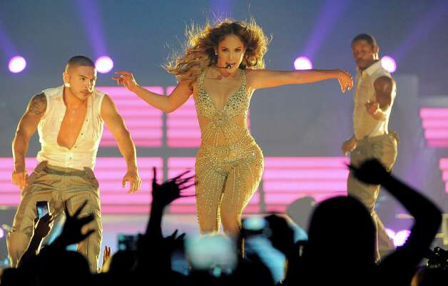 FILE - This Aug. 11, 2012 file photo shows Jennifer Lopez performing at the Honda Center in Anaheim, Calif.  Lopez and Enrique Iglesias are in the middle of a 20-city summer concert tour.  The pair will perform Friday, Aug. 17, at the Staples Center in Los Angeles. (Photo by Chris Pizzello/Invision/AP, file) Photo: Chris Pizzello, Associated Press / Invision