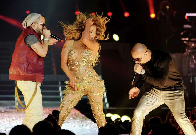 LOS ANGELES, CA - AUGUST 16:  Singers Jennifer Lopez (C) and Yandel (L) and Wisin (R) of Wisin y Yandel perform at The Staples Center on August 16, 2012 in Los Angeles, California. Photo: Kevin Winter, Getty Images / 2012 Getty Images