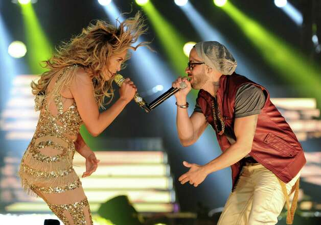 LOS ANGELES, CA - AUGUST 16:  Singers Jennifer Lopez (L) and Yandel (R) of Wisin y Yandel perform at The Staples Center on August 16, 2012 in Los Angeles, California. Photo: Kevin Winter, Getty Images / 2012 Getty Images
