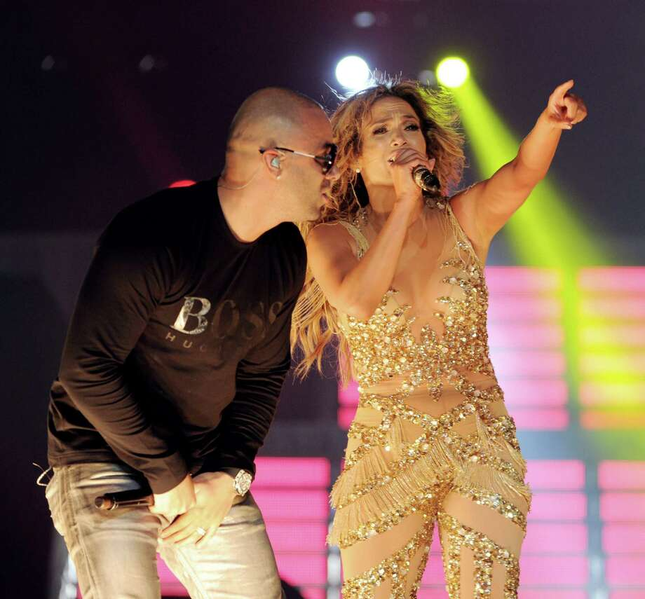 LOS ANGELES, CA - AUGUST 16:  Singers Jennifer Lopez (R) and Wisin of Wisin y Yandel perform at The Staples Center on August 16, 2012 in Los Angeles, California. Photo: Kevin Winter, Getty Images / 2012 Getty Images