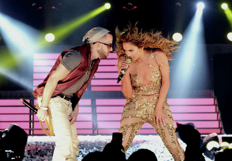 LOS ANGELES, CA - AUGUST 16:  Singers Jennifer Lopez (R) and Yandel (L) of Wisin y Yandel perform at The Staples Center on August 16, 2012 in Los Angeles, California. Photo: Kevin Winter, Getty Images / 2012 Getty Images