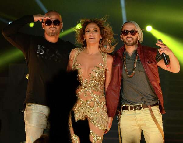 LOS ANGELES, CA - AUGUST 16:  (L-R) Wisin, Jennifer Lopez and Yandel perform on stage at Staples Center on August 16, 2012 in Los Angeles, California. Photo: Michael Buckner, Getty Images For Atlantico Rum / 2012 Getty Images
