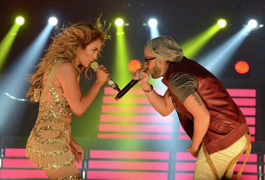 LOS ANGELES, CA - AUGUST 16:  Singer Jennifer Lopez (L) and singer Yandel and Atlantico Rum celebrate the Los Angeles show at Staples Center on August 16, 2012 in Los Angeles, California. Photo: Michael Buckner, Getty Images For Atlantico Rum / 2012 Getty Images
