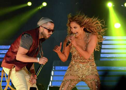 LOS ANGELES, CA - AUGUST 16:  Singer Yandel (L) and singer Jennifer Lopez and Atlantico Rum celebrate the Los Angeles show at Staples Center on August 16, 2012 in Los Angeles, California. Photo: Michael Buckner, Getty Images For Atlantico Rum / 2012 Getty Images