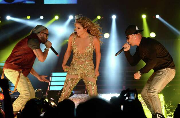 LOS ANGELES, CA - AUGUST 16:  (L-R) Yandel, Jennifer Lopez and Wisin perform on stage at Staples Center on August 16, 2012 in Los Angeles, California. Photo: Michael Buckner, Getty Images For Atlantico Rum / 2012 Getty Images