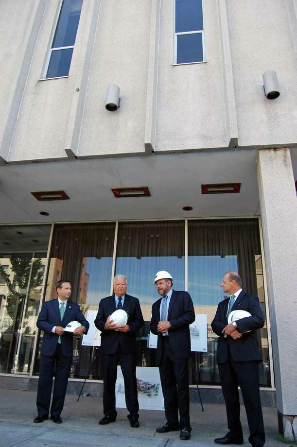 At the groundbreaking ceremony for Wall Street Place last summer are from left: State Sen. Bob Duff(D-Norwalk); Norwalk Mayor Richard Moccia; Ken Olson, managing partner of POKO Partners; and Emil Albanese, chairman of the Norwalk Redevelopment Agency. Photo: Nicole Rivard/Staff Photographer