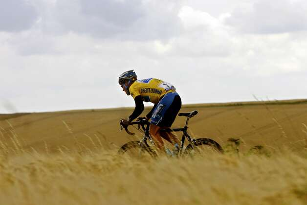 FILE - In this July 7, 2005, seven-time Tour de France winner Lance Armstrong of Austin, Texas, rides through the countryside during the sixth stage of the Tour de France cycling race between Troyes and Nancy, eastern France. Federal prosecutors said, Friday, Feb. 3, 2012, they are closing a criminal investigation of Armstrong and will not charge him over allegations the seven-time Tour de France winner used performance-enhancing drugs. (AP Photo/Alessandro Trovati, File) (AP)