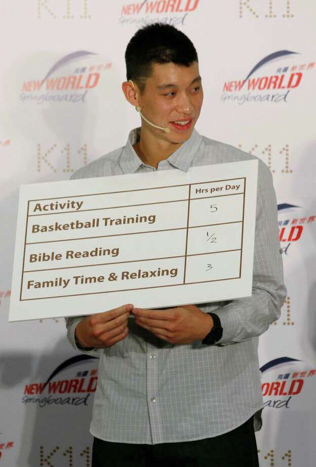 NBA basketball player Jeremy Lin shows his daily time table during a fan meeting in Hong Kong Friday, Aug. 24, 2012. Lin will play for Houston Rockets, a team China's former NBA player Yao Ming used to be with, next season on a three-year contract. (AP Photo/Kin Cheung) Photo: Kin Cheung, Associated Press / AP