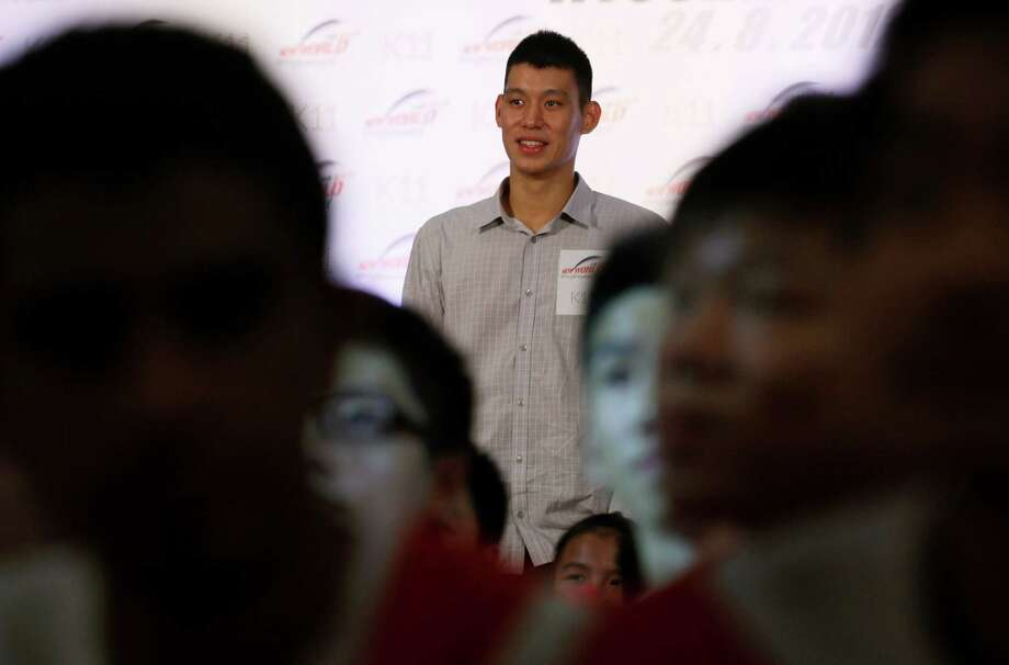 NBA star Jeremy Lin poses with his fans in Hong Kong Friday, Aug. 24, 2012. Lin will move to Yao Ming's former team Houston Rockets next season on a three-year deal. (AP Photo/Kin Cheung) Photo: Kin Cheung, Associated Press / AP