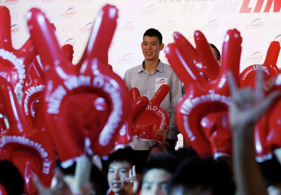 NBA star Jeremy Lin poses with his fan in Hong Kong Friday, Aug. 24, 2012. Lin will move to Yao Ming's former team Houston Rockets next season on a three-year deal. (AP Photo/Kin Cheung) Photo: Kin Cheung, Associated Press / AP