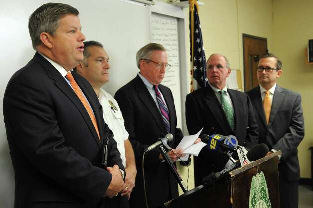 Police Commissioner Christopher Weldon, left, speaks during a press conference at the Wilton Police Department to announce the arrest of a minor in the death of Nicholas Parisot, who was killed in 2008 at the age of 13 when he struck a rope strung across a trail while riding a dirt bike. Photo: Lindsay Niegelberg / Stamford Advocate