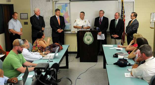 Wilton Police Chief Michael Lombardo, center, speaks during a press conference at the Wilton Police Department to announce the arrest of a minor in the death of Nicholas Parisot, who was killed in 2008 at the age of 13 when he struck a rope strung across a trail while riding a dirt bike. Photo: Lindsay Niegelberg / Stamford Advocate