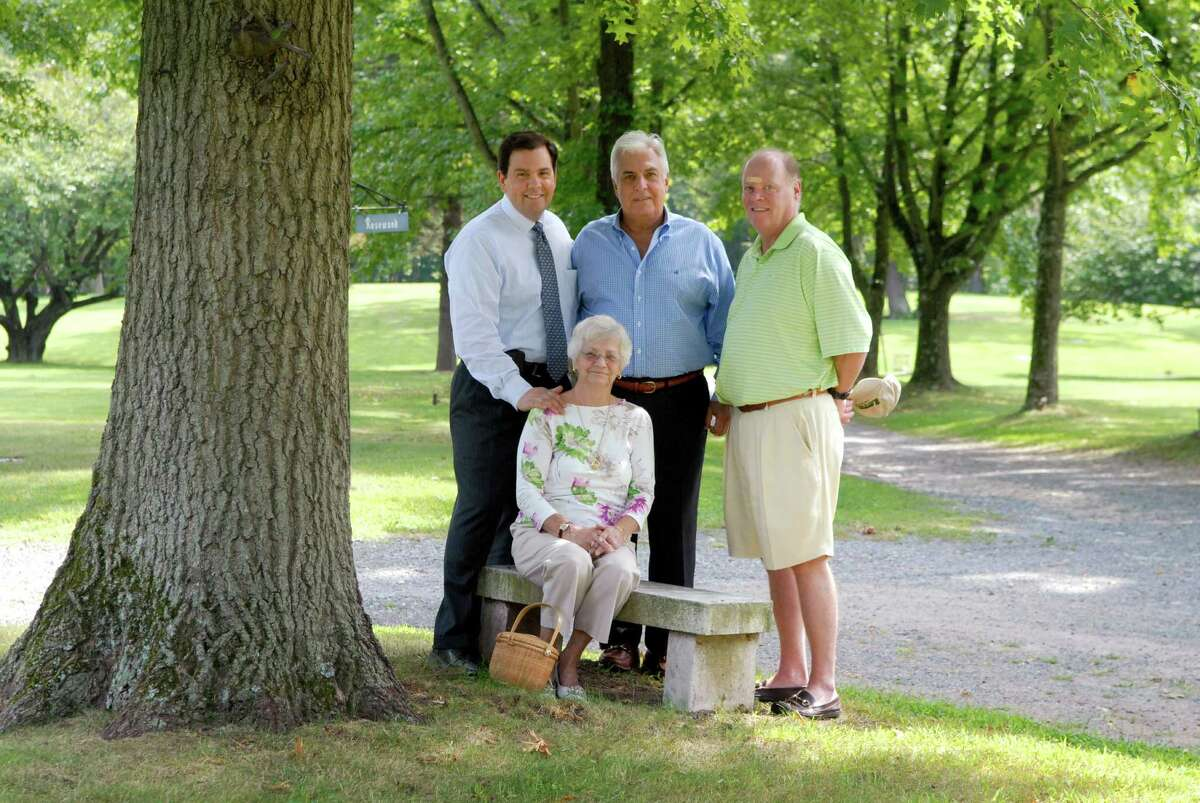 The new board of directors is turning around Fairfield Memorial Park, a cemetery on Oaklawn Avenue in Stamford, Conn. that was the subject of a state investigation nearly 20 years ago. Board members include grave owner Dody Green (seated), Jerry Bosak, a Stamford funeral home owner, cemetery manager Carl Caputo of Stamford and monument company owner Don Foley. They are photographed in the cemetery on Friday August 24,2012.