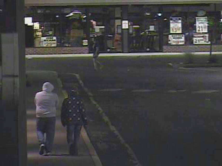 "New Milford are trying to identify two ""persons of interest"" who are being sought in connection with the robbery of a Radio Shack on Monday, Aug. 20, 2012. Photo: Contributed Photo"