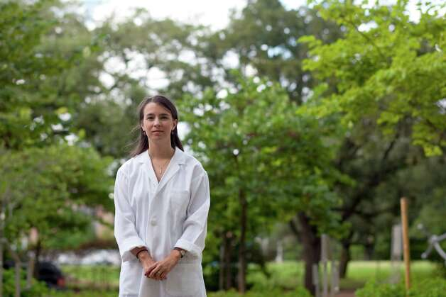 """Pictured outside the Rice University BioScience Research Collaborative, Meaghan Bond, 24, a third year bioengineering PhD student at Rice University, has lived with the West Nile virus since she was bitten by an infected mosquito while at church camp in 2003 Thursday, Aug. 23, 2012, in Houston.  Today, Bond says she still has symptoms of fatigue, lower immune system and headaches from the virus. The virus took four years to diagnose. A doctor even asked if she thought that her parents might be poisoning her while trying to determine what she had. When asked if she is extra cautious now about wearing bug spray, """"I already have West Nile, so, no,"""" Bond said. Photo: Johnny Hanson, Houston Chronicle / © 2012  Houston Chronicle"""