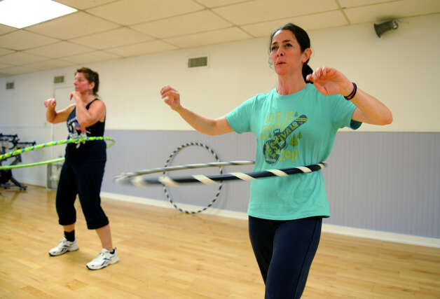 Staff reporter Christina Hennessy takes part in a hula hoop exercise class at the YMCA in Fairfield, Conn. on Tuesday August 7, 2012. Photo: Christian Abraham / Connecticut Post