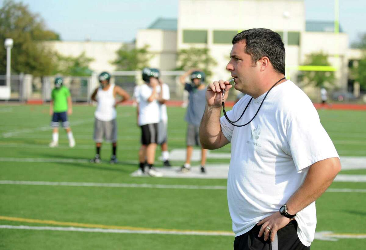 Coach Sean Ireland blows the whistle during Norwalk High School's football practice at the school on Friday August 24, 2012.