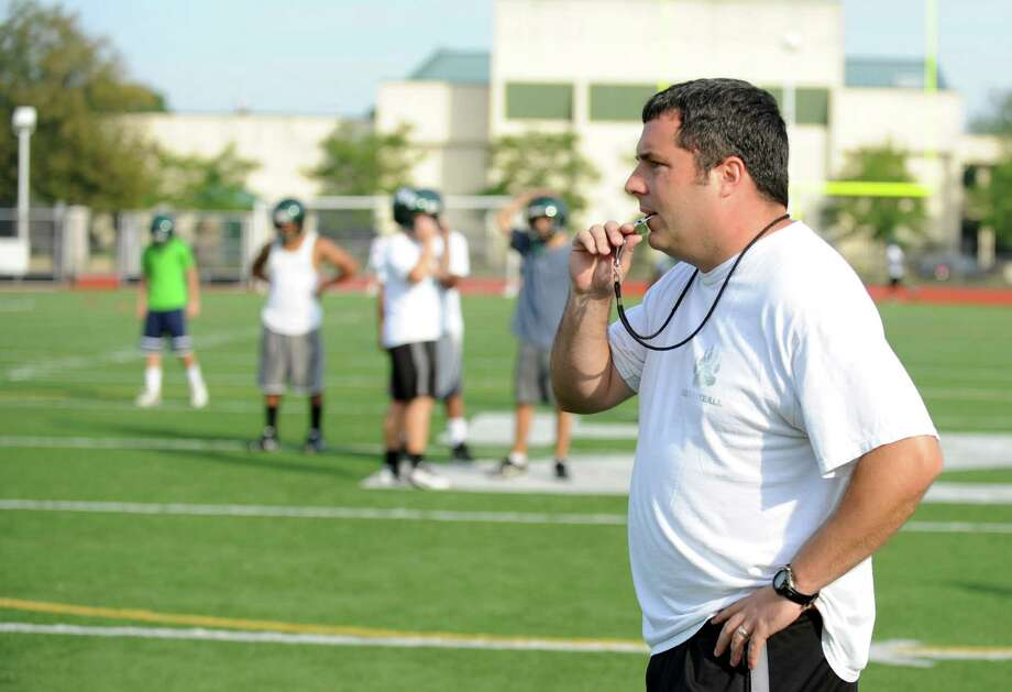 Coach Sean Ireland blows the whistle during Norwalk High School's football practice at the school on Friday August 24, 2012. Photo: Lindsay Niegelberg / Stamford Advocate