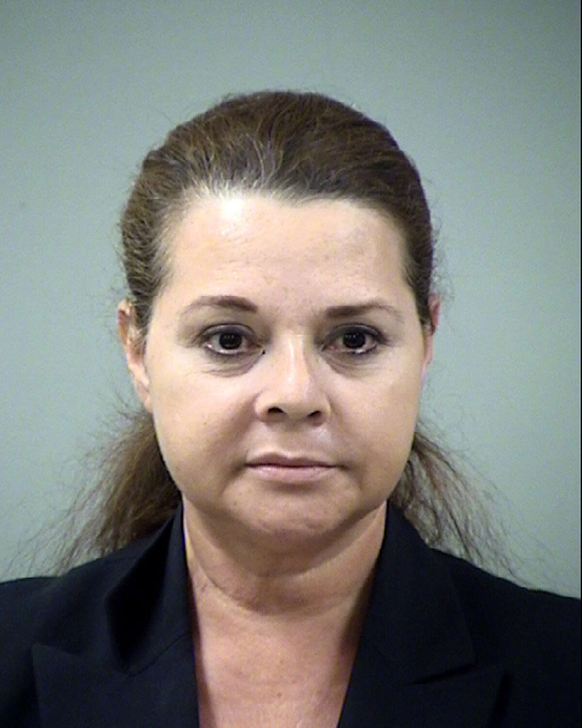 Hilda Valadez is seen in an Aug. 23, 2012 Bexar County Sheriff's Department booking mug taken after she was charged with 46 felony counts that include forging judges' signatures and double-billing the county.