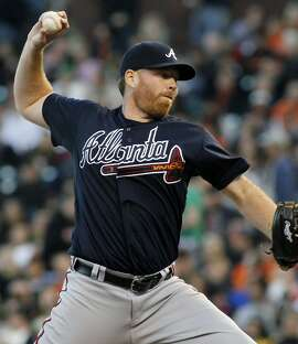 Atlanta Braves pitcher Tommy Hanson throws to the San Francisco Giants during the first inning of a baseball game in San Francisco, Thursday, Aug. 23, 2012. (AP Photo/George Nikitin)