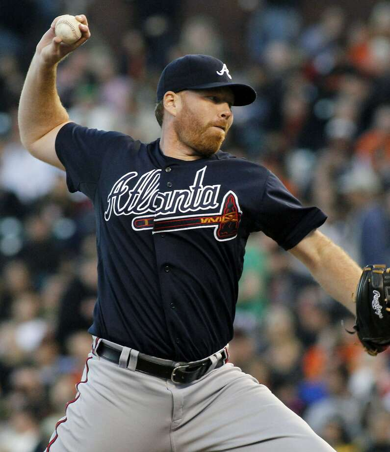 Atlanta Braves pitcher Tommy Hanson throws to the San Francisco Giants during the first inning of a baseball game in San Francisco, Thursday, Aug. 23, 2012. (AP Photo/George Nikitin) Photo: George Nikitin, Associated Press