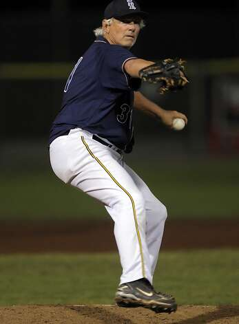 "Bill ""Spaceman"" Lee pitches in the ninth inning on his way to defeating Maui's Na Koa Ikaika at Albert Park in San Rafael, Calif., on Thursday, August 23, 2012. At 65, Bill ""Spaceman"" Lee became the oldest man to win a professional baseball game when he pitched a complete game on Thursday for the San Rafael Pacifics. Photo: Carlos Avila Gonzalez, The Chronicle"