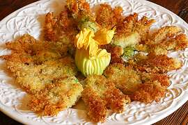 Sauteed squash blossoms cooked by Jacqueline Higuera McMahan for South to North column, August 2012