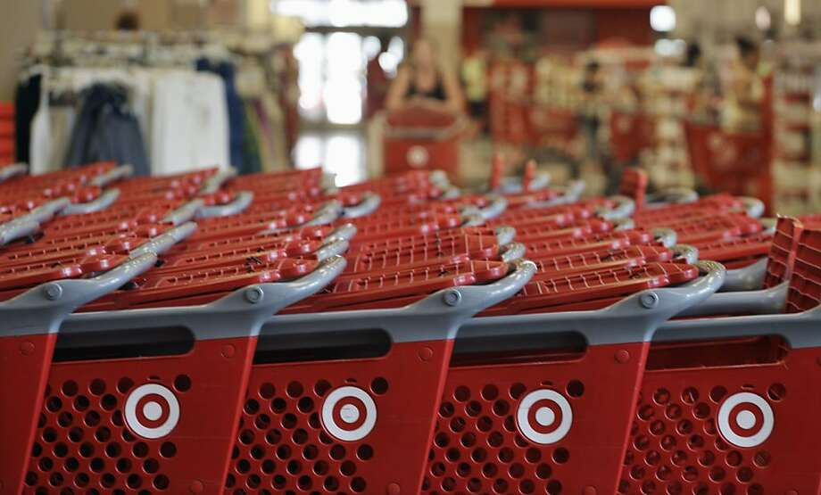 FILE- In this Thursday, July 5, 2012, file photo, rows of carts await customers at a Target store in Chicago. Discount retailer Target Corp. said Thursday, Aug. 2, 2012 that a key revenue measure rose more than expected in July, as more shoppers visited its stores and spent more on their purchases. (AP Photo/M. Spencer Green, File) Photo: M. Spencer Green, Associated Press