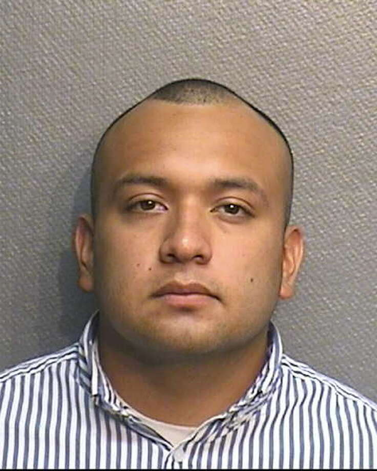Ray Faustino Acuna, a former Houston police officer, is accused of robbing the office where his wife worked. Photo: Handout