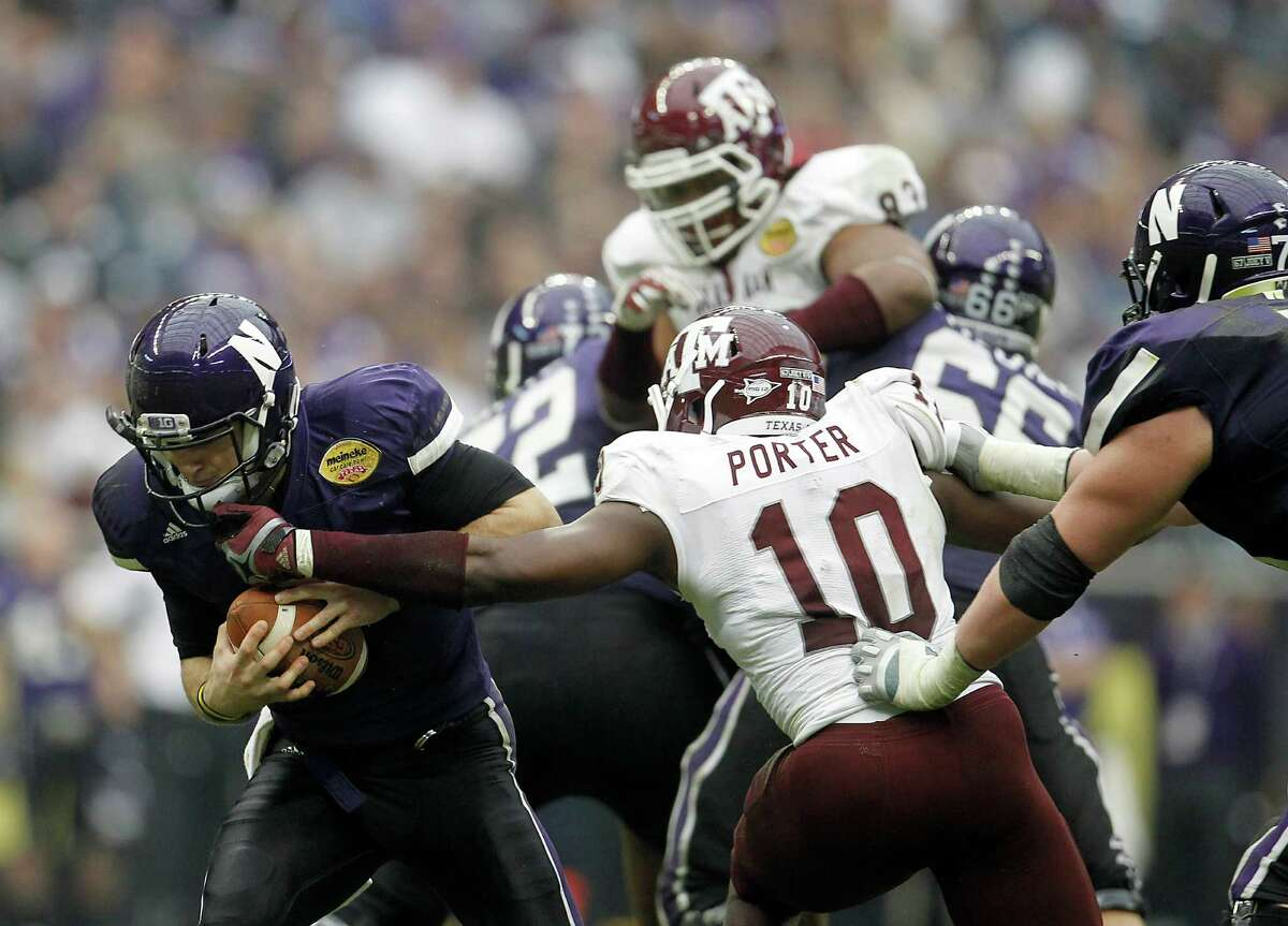 Northwestern Wildcats quarterback Dan Persa (7) is sacked by Texas A&M Aggies linebacker Sean Porter (10) during the third quarter of the Meineke Car Care Bowl at Reliant Stadium,Saturday, Dec. 31, 2011, in Houston. Texas A&M won the game against Northwestern University 33-22.