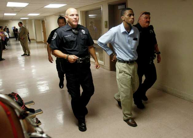 Lorenzo Leroy Thompson, 23,  is escorted Friday morning Aug. 23, 2012 out of Judge Melisa Skinner's 290th State District Court after he was sentenced to life in prison without the possibility of parole for the murder of Vanessa Marie Pitts, 25. Photo: William Luther, San Antonio Express-News / © 2012 San Antonio Express-News
