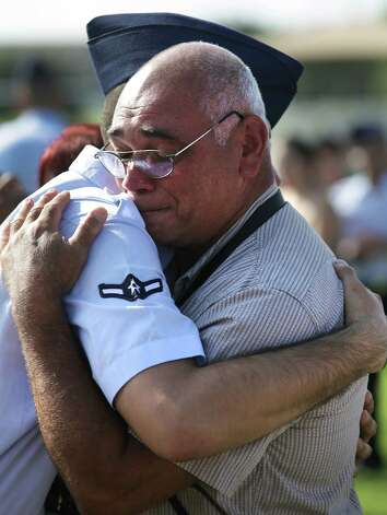 Brandon Soto (left) is embraced by his grandfather Antonio Velez  following Soto's graduation from basic training at Joint Base San Antonio-Lackland.