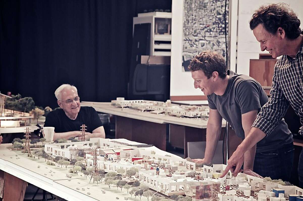 Architect Frank Gehry, left, and Facebook co-founder Mark Zuckerberg ,center, reviews the Facebook West design with Gehry's partner, Craig Webb.