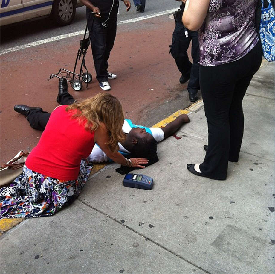 This photo posted to an Instagram account belonging to a person identified as mr_mookie, an eyewitness at the scene, shows a victim of a shooting being tended to by pedestrians outside the Empire State Building in New York, Friday, Aug. 24, 2012. The identity or condition of the victim was not immediately known. Law enforcement officials in New York City say at least four people have been shot outside the Empire State Building in violence that stemmed from a workplace dispute, and that the gunman has been killed by police. The shooting happened at about 9 a.m. Friday at 34th Street and Fifth Avenue. (AP Photo/mr_mookie via Instagram) Photo: Mr_mookie, Associated Press / AP