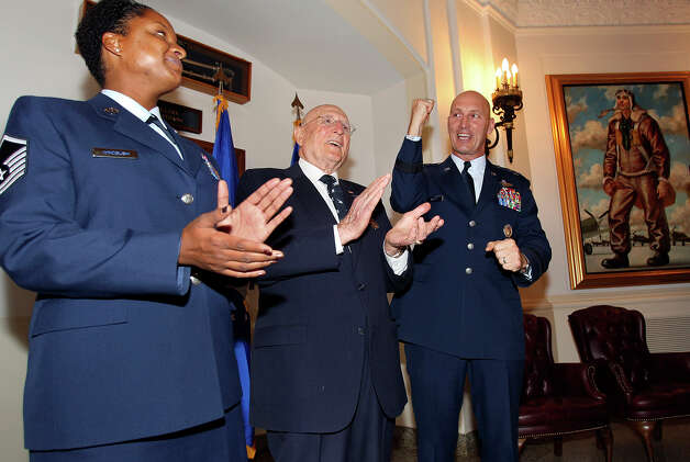 Major General Timothy Zadalis pumps his fist while Samuel W. Smith sings the Air Force Song with Sgt. Marti L. Windbush after he is presented the Distinguished Flying Cross by Major General  Zadalis in a ceremony at Randolph AFB on August 24, 2012. Photo: Tom Reel, San Antonio Express-News / ©2012 San Antono Express-News