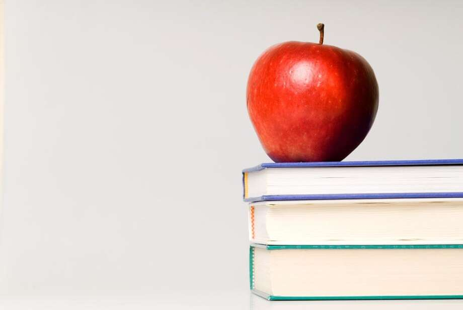 red apple and stack of books for school / handout / stock agency