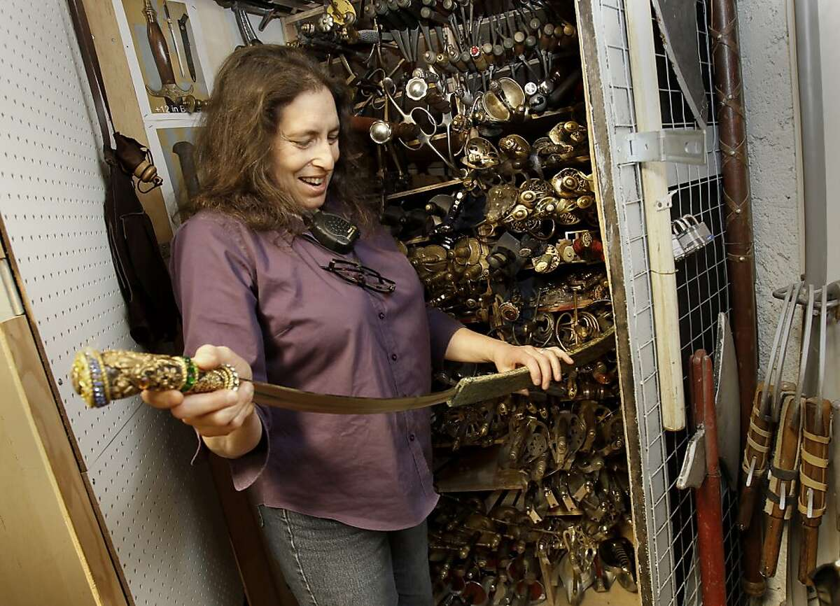In the armory property room, Lori Harrison smiles to herself as she recalls the making of a sword years ago. Lori Harrison is the first female properties master at the San Francisco Opera. Props are stored throughout the catwalks, on shelves, in every nook and cranny at Opera House.