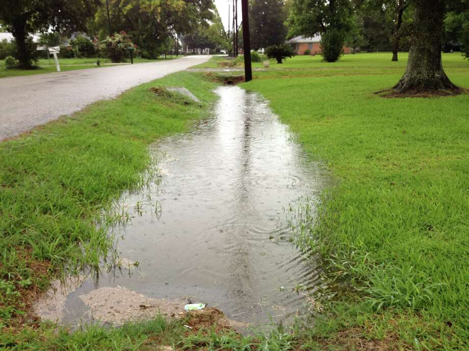 How can I get rid of standing water in neighborhood ditches