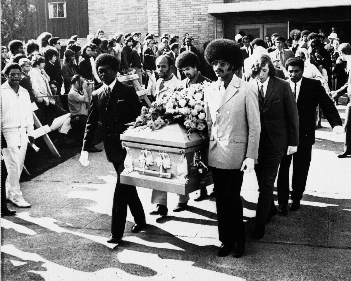 Friends of Jimi Hendrix carry his coffin after a funeral service at Dunlop Baptist Church in Renton on Oct. 1, 1970. Pallbearers include Herbert Price, left, Hendrix' valet; Donny Howell behind Price; and Eddie Rye, front right. Hendrix died in London from drug-related complications. He was 27. Photo: Barry R. Sweet, ©2012 The Associated Press, published with permission.