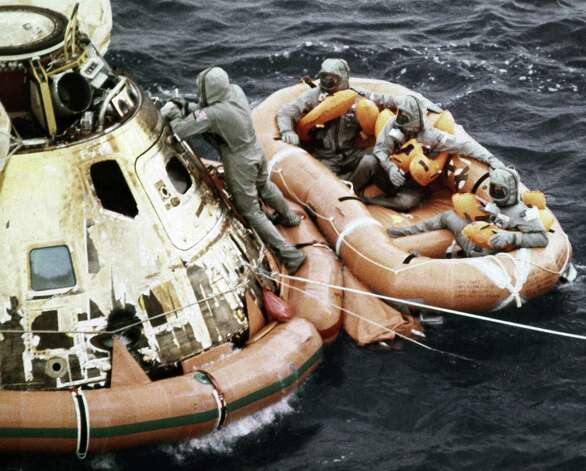 Apollo 11 astronauts wait for a helicopter pick-up in the Pacific Ocean on July 24, 1969, after their return to Earth. Photo: Barry R. Sweet, ©2012 The Associated Press, published with permission. Photo: ASSOCIATED PRESS